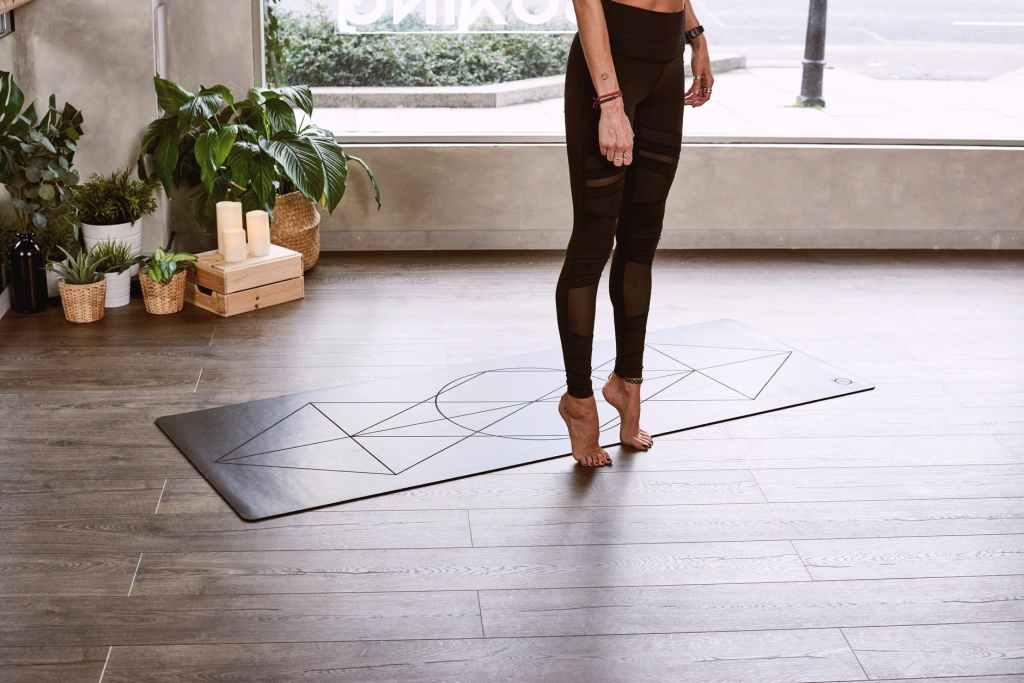 woman tip toeing on floor